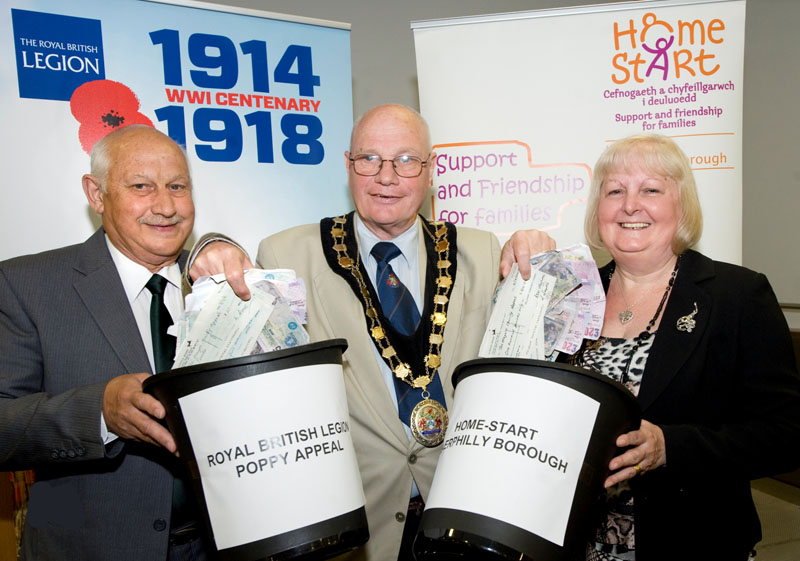 Mayor of Caerphilly county borough Cllr David Carter pictured with the Royal British Legion's Ken Terry and Gillian Jervis of Home-Start Caerphilly Borough