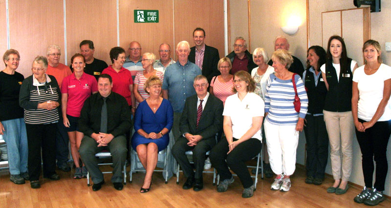 Minister Mark Drakeford AM (seated) with walkers and staff of Monmouthshire's leisure services