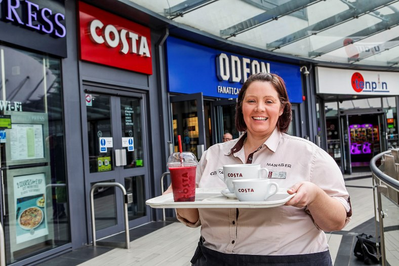 Eagles Meadow new Costa Manager Claire James outside the shop