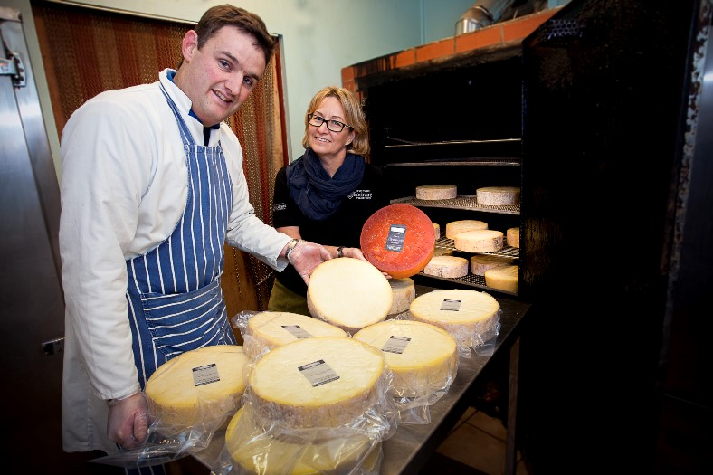 BODNANT WELSH FOODS . Pictured at Chirk Smokery is Richard Simpson with Debbie Leviseur, dairy sales and marketing at Bodnant .