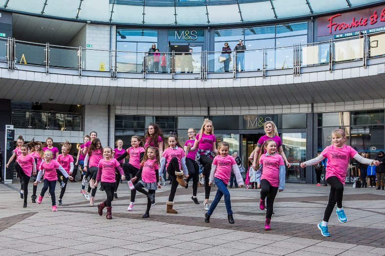 Flashmob by 20 girls from Wrexham Pantomime Company at Eagles Meadow, Wrexham.