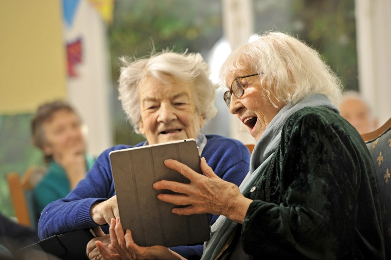 Penpergwm House Residential Care Home, Penpergwm, Abergavenny, where the residents are attending ipad classes to make them more internet savvy. Residents Anne Usborne, aged 86, left, and Joy Storey, aged 90, right, take a virtual climb up Mount Everest on their ipad.