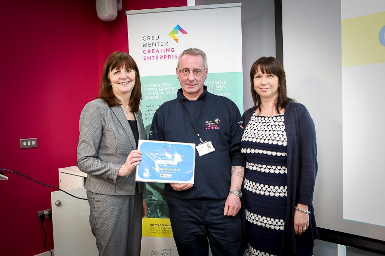 Cartrefi Conwy HQ in Abergele and its a briefing to Lesley Griffiths about Creating Enterprise. Pictured: Certificates for completions. Lesley Griffiths, Mark Burroughs receives certificate with Sharon Jones Partnership Director for Creating Enterprise