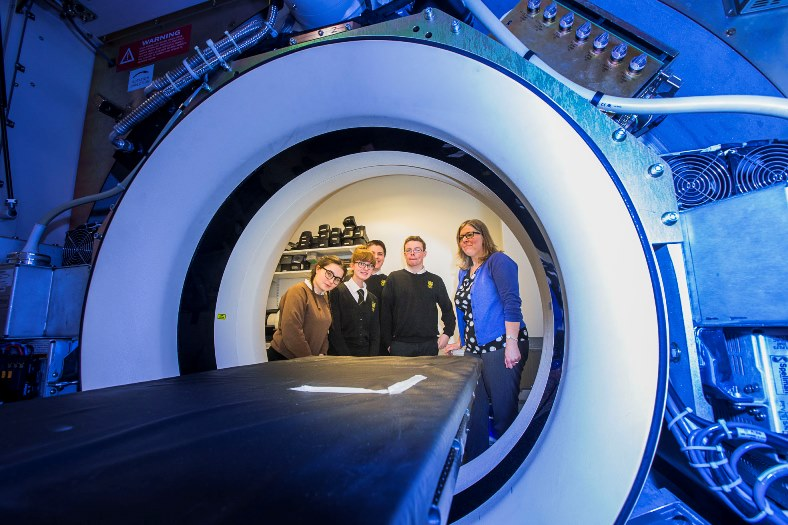 Sixth form students from North Wales schools have visited the Medical Physics dept, Glan Clwyd Hospital,  learning about careers in the health service, using physics. Ysgol Glan Clwyd students, from left, Gwen Williams, Natasha Maitland-Davies, Matthew Baines, Iwan Stanyer with Llynn Bateman at the CT Scanner