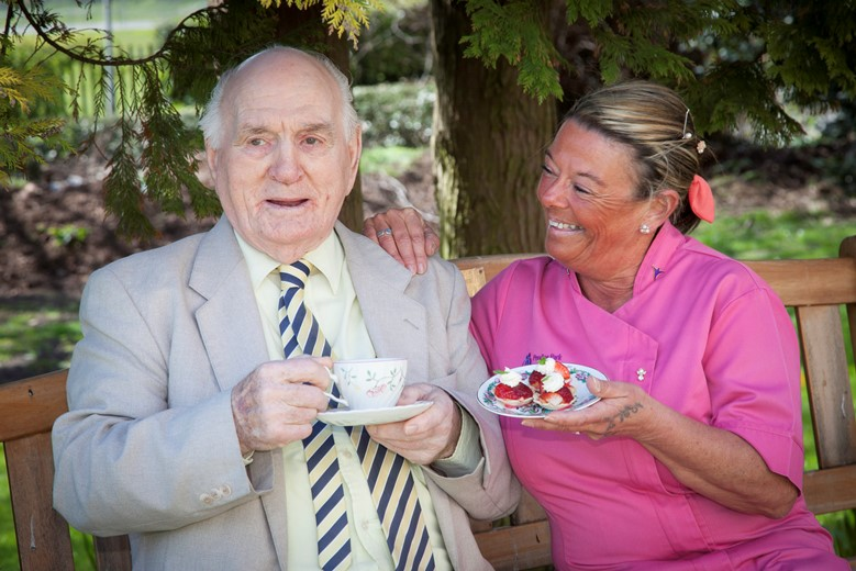 PENDINE PARK... Pictured is resident Bill Evans,91 who has been invited to the Queens Garden party and is taking  his Pendine Park care practitioner Mandy Williams as his guest.