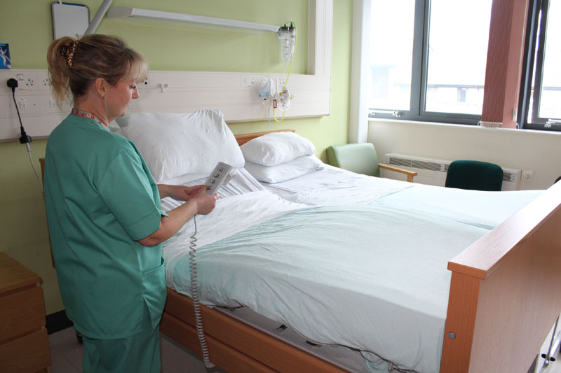 Nursery nurse, Caroline Thomas with the new bed on first floor maternity unit at the University Hospital of Wales