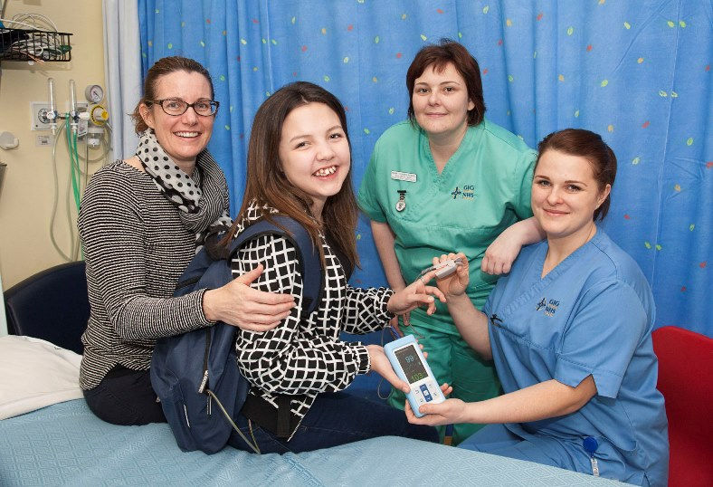 Amy Willis and her Mum Andrea have raised £10,000 with help from firends to purchase a hand-held heart monitor for Wrexham Maelor Hospital children's ward where Amy received excellent care and support, pictured with Play Co-ordinator Emma Cunnah- Newell and nurse Jenna Hughes with the Portable Monitor