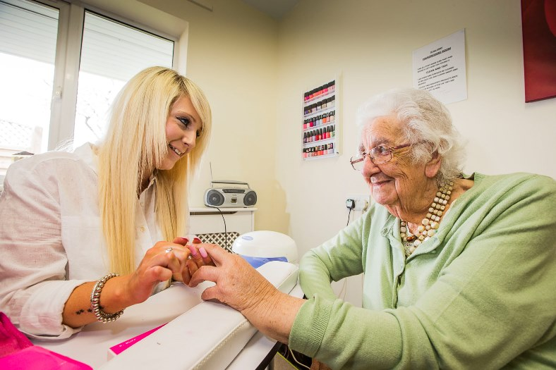 Pen Y Bryn Care Home in Bagillt have recently completed a £1million extension and have created a 'nail bar' for the residents. Senior Carer Rebecca Hughes does the nails of resident Joyce Hughes.