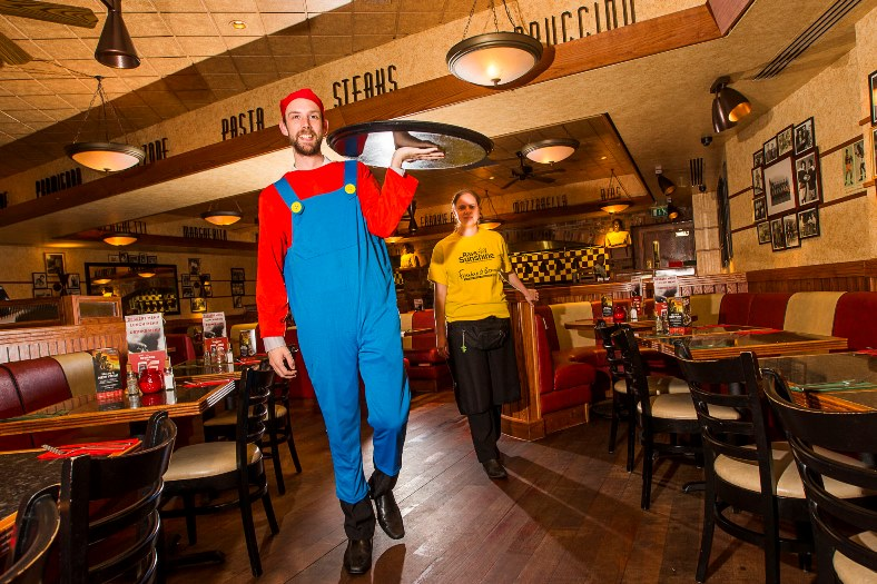 Staff at Frankie and Benny's in Eagles Meadow, Wrexham are raising money for the Rays of Sunshine charity. Andy Whitehouse in the Super Mario outfit with Natalie Dunn