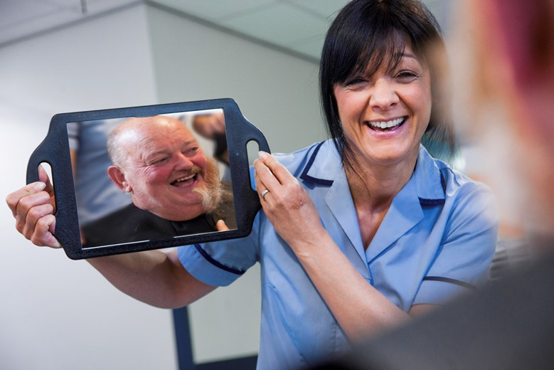 BCUHB...Ysbyty Glan Clwyd  Stroke unit where Local businessman Eddie Lloyd Davies had his beard shaved off for charity . Technical instructor Julie Hirst shows Eddie Lloyd Davies half way through the shave.