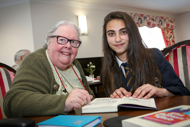 Ysgol John Bright students have taken part in a reading project with residents at Cysgod y Gogarth in Llandudno. Pictured: Pat Farley with Belda Yumrova age 12