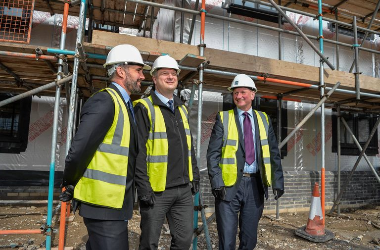 12/04/16 Llanfairfechan. Cartefi Conwy Site. Pictured: Howard Vaughan (Brenig Construction), David Kelsall (Cartrefi Conwy) and Mike Roberts (Beech Developments).