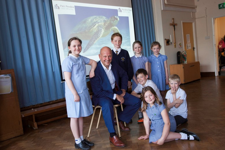 Pendine Park.... Mario Kreft visits Trefnant school where he used to go as a boy and talks to pupils. Pictured is Mario Kreft with Pupils Lillie Young, Millie Maxwell, Thomas Evans, Will Kellett, Charlie Porter, Hattie Orton and Olivia Schrimshaw.