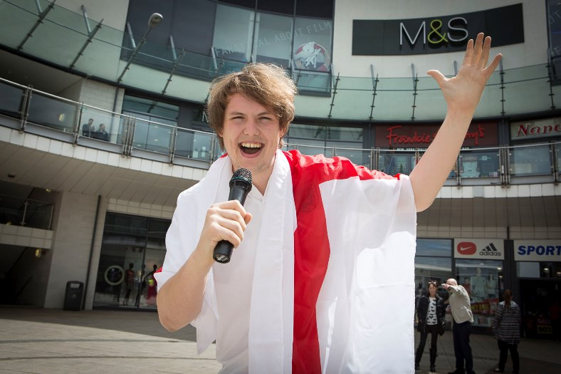 Eagles Meadow, Wrexham.  Capital Radio 1 DJ Ben Sheppard sings English national anthem for a bet as they beat Wales in the Euro's. Pictured: Ben singing