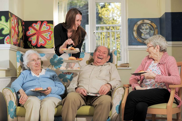 Rowan House Care Home, Griffithstown, Pontypool, where the residents enjoy an old fashioned tearoom. Emily Baines, Admin Assistant, middle, serves the cakes to left to right, Marjorie Andrews, aged 77, John Symons, aged 83, and Liz Vowles, aged 76.