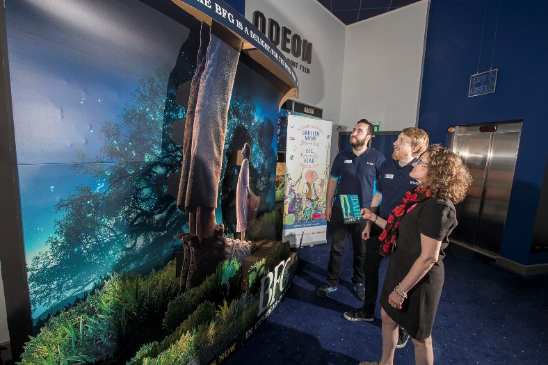 Shan Cooper from the childrens library at Wrexham Councilw ith Odeon staff at Eagles Meadow, Liam Miles, right and Stephen Powell with the BFG display