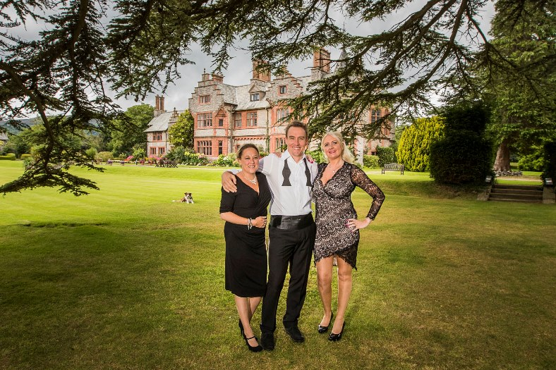 Caer Rhun Hall in Conwy.  Gavin Mart, who is organising Gorjys Secret, a singer songwriter festival there in September pictured with Tansy Rogerson and Anna Openshaw
