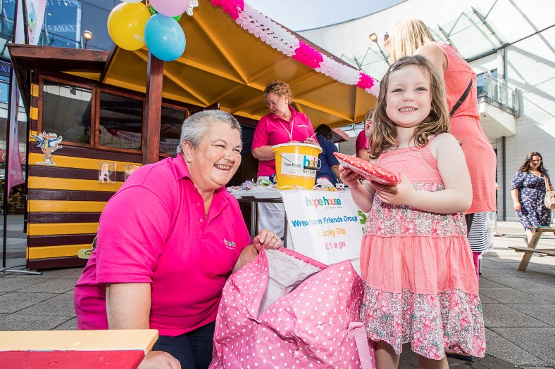 Wrexham Friends of Hope House children's hospice have held a special holiday event in the Roald Dahl story shack in Eagles Meadow in Wrexham. Karen Price form Wrexham Friends of Hope House helps four years old Megan Evans from Penycae select her lucky dip
