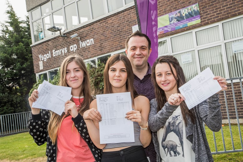Emrys ap Iwan, Abergele, A level results, teacher Ray Wood with, from left, Maisie Pepper, Hannah Mainon and Chloe Roberts.