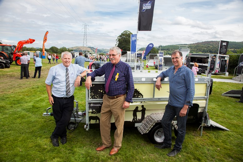 Ifor Williams Trailers at meirionnydd show ,rhug corwen . Pictured are Iorwerth Roberts fom IWT , Richard Jones President Royal Welch show 2016 and Winner of the trailer Dafydd Jones.