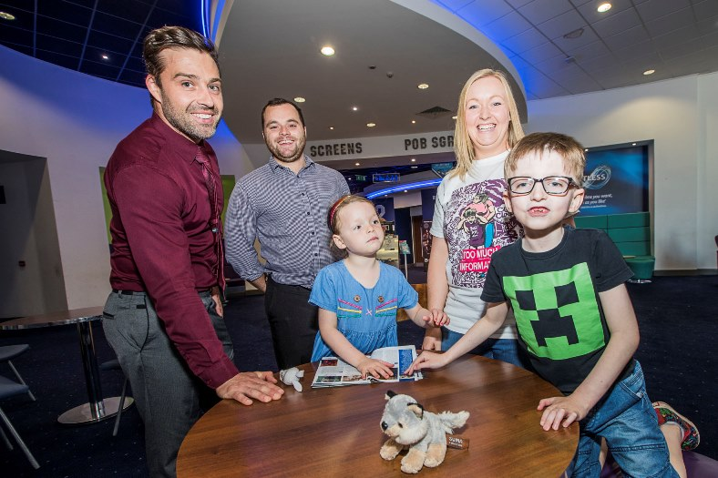 Evan McLeod-Andrews, 8 with mum Kelly, sister Riley, 5 with Odeon managers at Eagles Meadow, Dan Cheesbrough, left andf Steve Short.