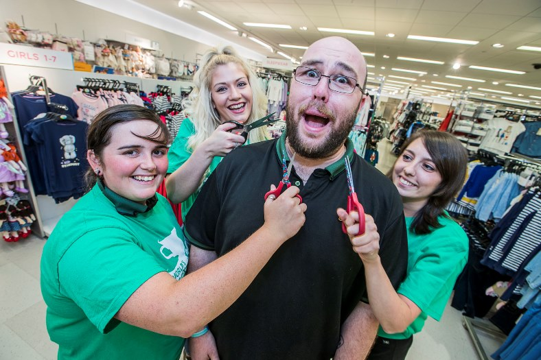 John Breeze whi is having his beard saved for charity at M&S in Eagles Meadow in Wrexham with staff, from left, Sarah Davies, Jodie Saxton and Becci Evans.
