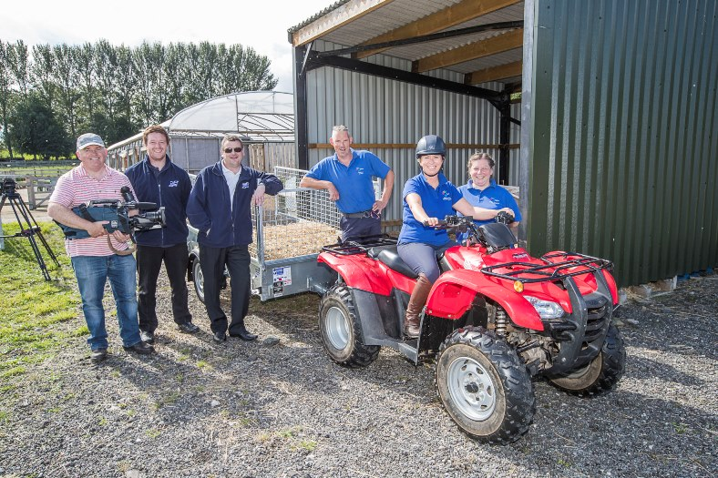 Ifor Williams Trailers, filming for Ffermio. Cameraman Gareth Vaughan Jones with the 'cast', from left, Steffan Parry, Andy Price, Pete Evans, Kate Jones and Wendy Gacem.