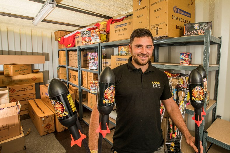 Lock Stock's  fireworks sales are rocketing and Liam Baker is pictured wth some of the stock.