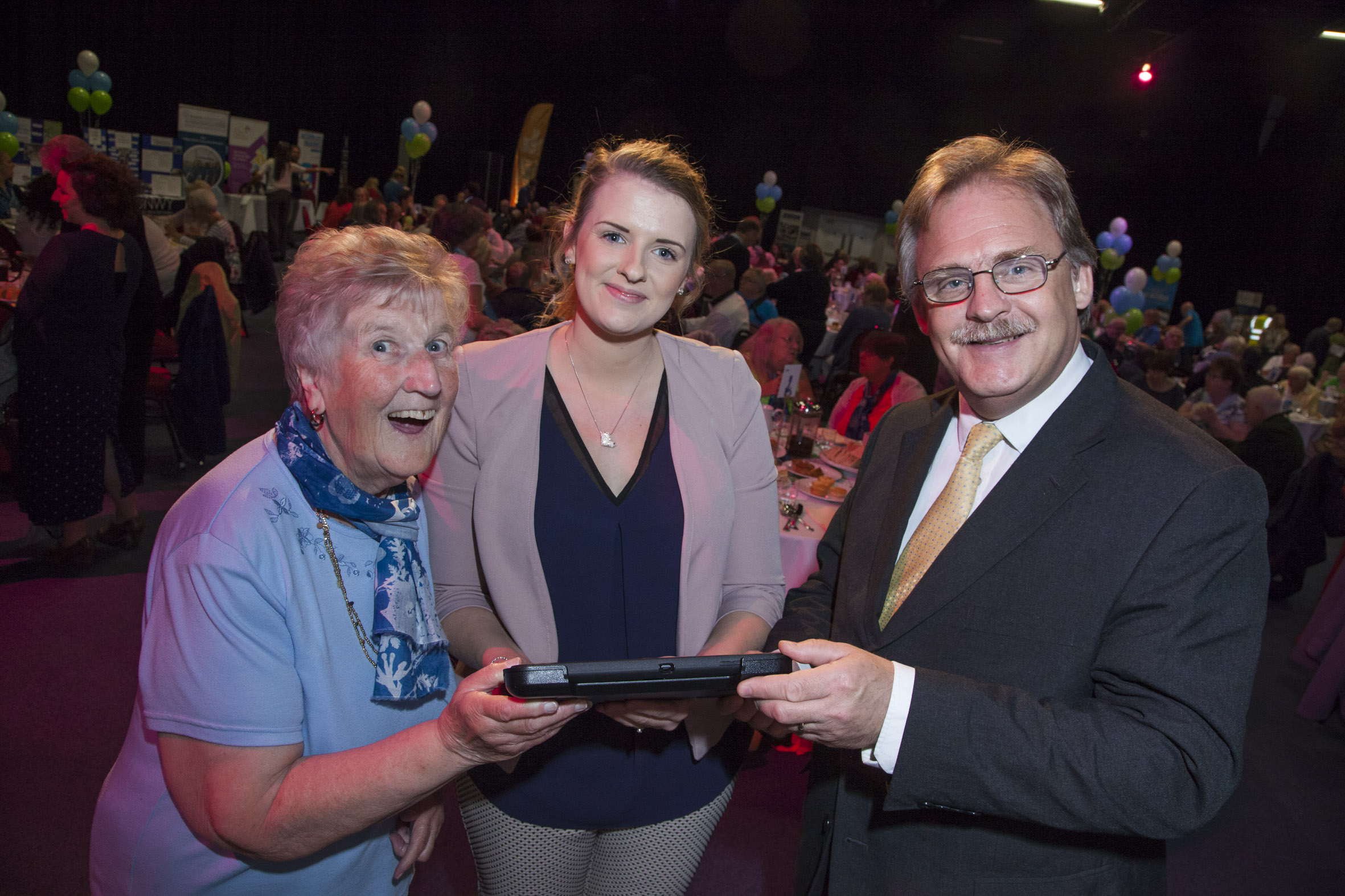 Cartrefi Conwy's Older Person's Day at Venue Cymru. Pictured is Phyllis Parry, Claire Twamtey and Mark Isherwood.