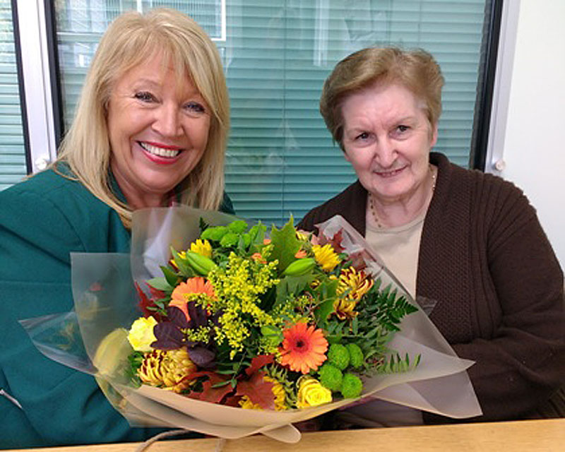 Maria Battle, Chair of Cardiff and Vale university Health board presenting Liz Hooper with a bouquet of flowers