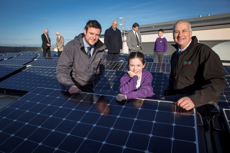 Hafod Renewables solar panels at the Holywell Superschool... Pictured are David and Richard  Jones of Hafod renewables with Ysgol Maes Y Felin  pupil Jessica Bailey on the roof  along with (From Left) Ysgol Treffynnon Headteacher Mr John Weir with Cllr Peter Curtis FCC , Cllr Chris Bithell Executive member education and youth FCC, Head Teacher of Ysgol Maes Y Felin Pete Davies and pupil Alan Birch.