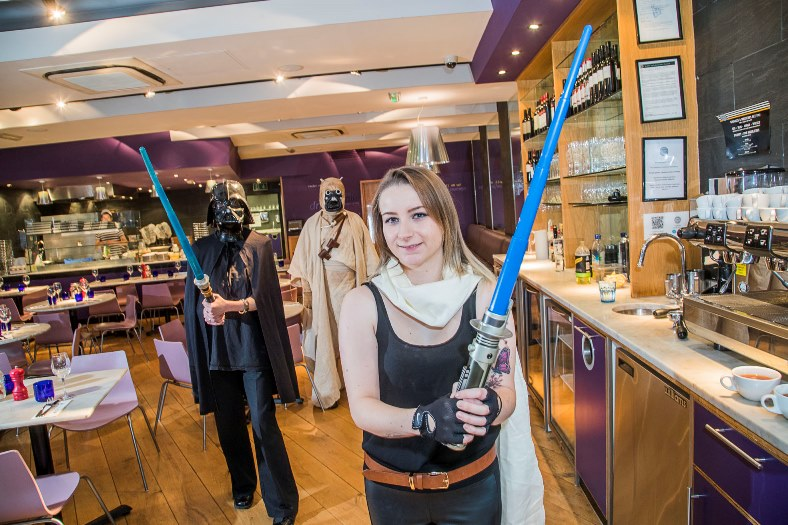 Pizza Express. staff in costume, in aid of Macmillan cancer charity, to coincide with launch next week of the new Star Wars film. From left, Celine Larnicol, Robert Williams-Day and Ceri Jones.