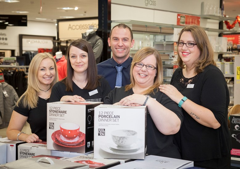 Debenhams at Eagles Meadow in Wrexham have employed workers from BHS. Pictured: Two of the new recruits Sharon Jones and Claire Littler are welcomed to their new jobs by Debenhams staff Siobhan Clifton, Manager Chris Gilston and Gemma Lyons