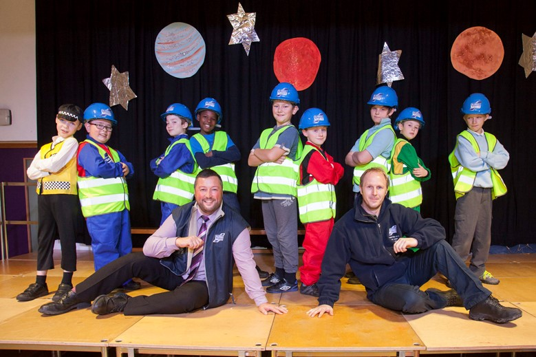 Pupils from Ysgol Bro Dyfrdwy in Cynwyd enjoyed a Christmas show with a difference with youngsters performing a Rap about Ifor Williams Trailers. Pictured: Ifor Williams Trailers' Rob Small and Geraint Jones along with rappers, year 5 & 6 pupils.