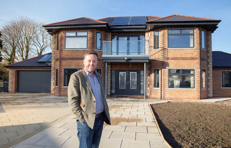Peninsula Home Improvements proprietor Ken Grayson visits the home of Marin Fell which is one of the first in the UK to install LUMI windows and doors in his newly built home in Angelsey.