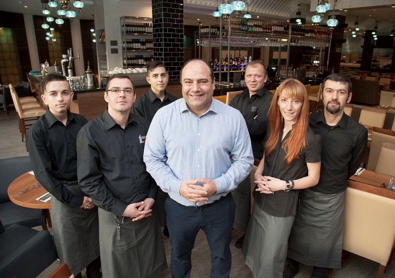"A new Turkish Restaurant in Eagles Meadow in Wrexham ""Turquoise"" has opened for Business. Pictured"" Proprietor Cevdet Mutlu with some of his many staff"