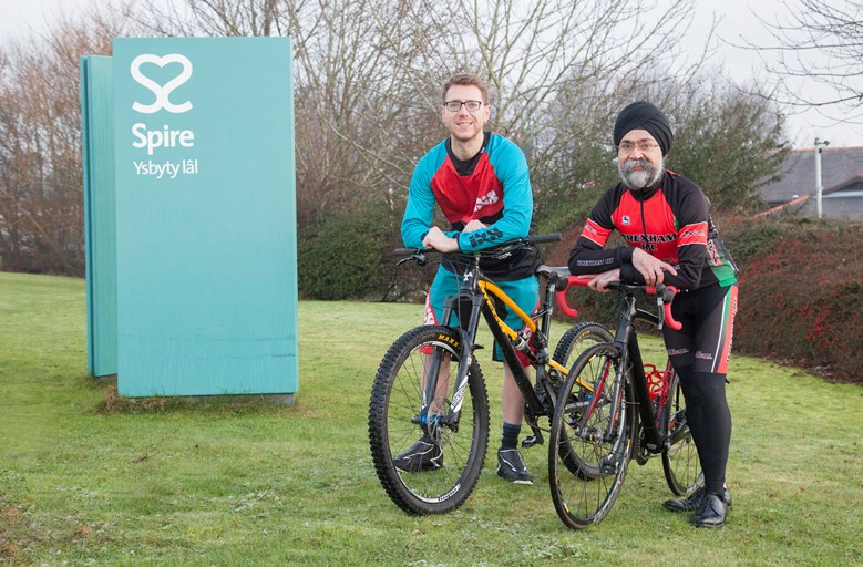 Spire Yale patient Matthew Booth is delighted with the excellent care and treatment he had at Spire Yale in Wrexham from Consultant Mr Raminder Singh who is also a keen cyclist and a member of Wrexham Cycling Club. Pictured: Matthew Booth and Mr Raminder Singh