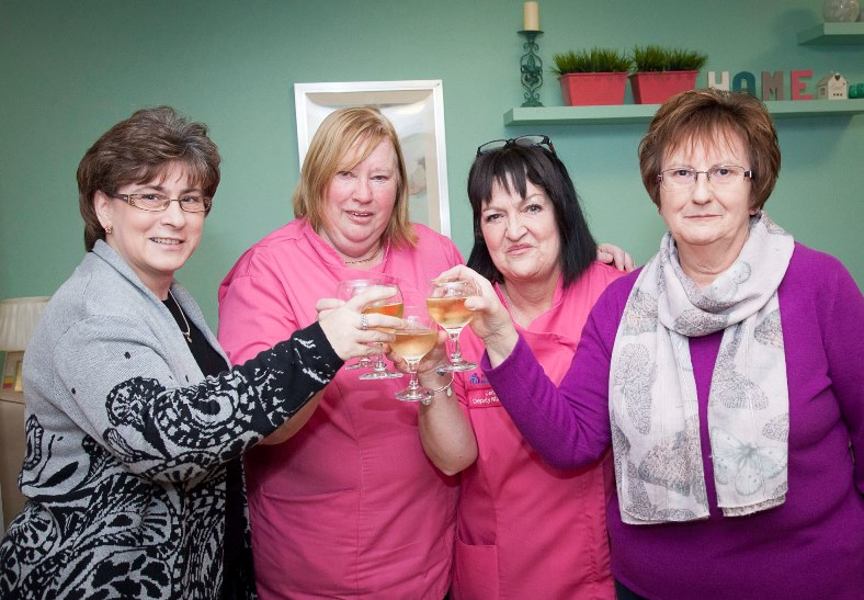 Pendine's Hilbury Care Home in Wrexham say a fond farewell to Joan Price who retires after 40 years service. Pictured: Joan Price celebrates with a glass of bubbly along with Cindy Clutton, Janet Clayton and Ann Edwards