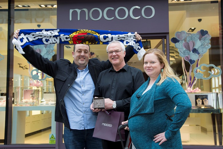 Pictured at Eagles Meadow Wrexham are competition winners   Richard Baker and Louise Andrews from Connah's Quay with Manager of Mococo Russell Hooson (CENTRE)