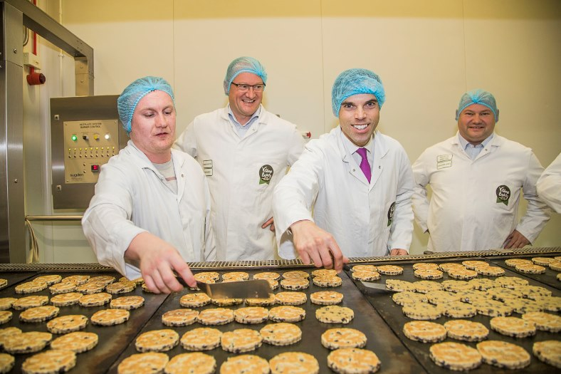 Ken Skates AM visited Village Bakery on Wrexham Industrial Estate. Pictured with Robin and Christian Jones and Anthony Dougherty on the Welsh Cakes production line