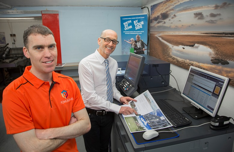 Powlsons the printers at Colwyn Bay,  £70,000 investment in a new digital printing machine that will safeguard jobs and bring more business into the town. Pictured are  James Large and MD, John Jones.