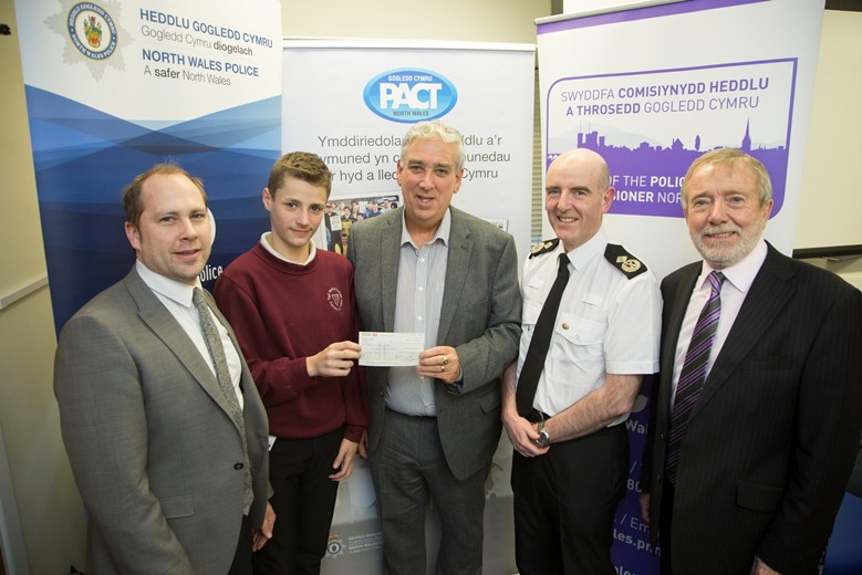 Pictured at the Your Community Your Choice awards are, from left, Denbighshire winners Prestatyn High School Young Rangers, from left, student liaison officer James Williams and pupil Sean Mahar, with North Wales Police and Crime Commissioner Arfon Jones, Deputy Chief Constable Gareth Pritchard and David Williams, chairman of the Police and Community Trust.