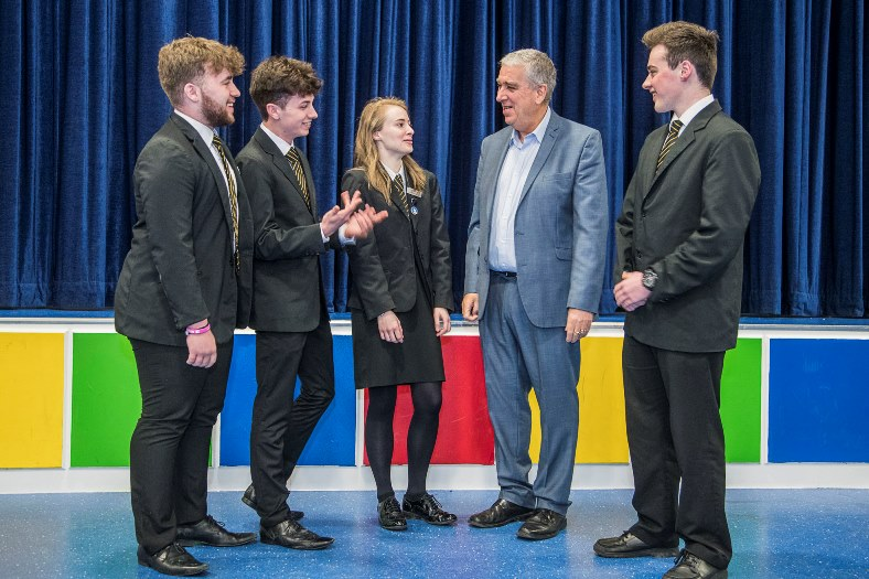 Police and Crime Commissioner Arfon Jones talks to students at Ysgo John Bright in Llandudno. From left, Angus Palin, 17, Cai Williams, 17, Georgina Gakes,18 and Harvey Ryan, 18.