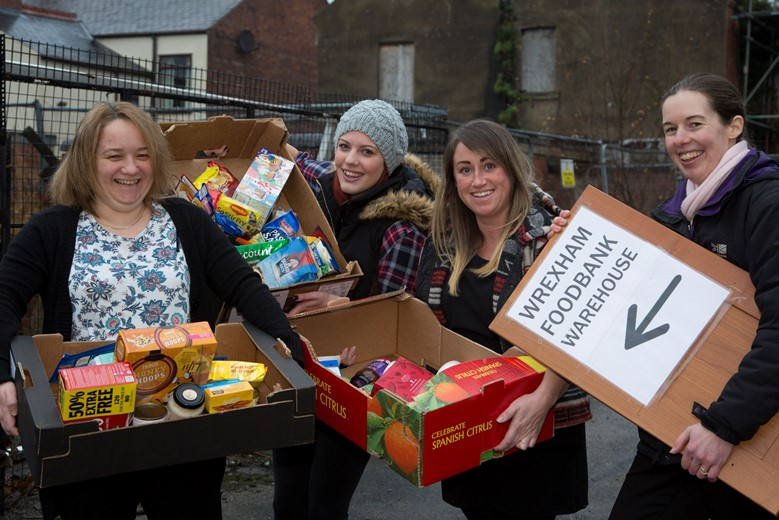 Pendine Park Smartcare Staff donate  food parcels and other goodies to Sally Ellison at the foodbank centre, Wrexham.... Pictured (from Left) are Rebecca Griffiths, Sarah Morse and Kelly Humphreys with Sally Ellison from Wrexham foodbank.