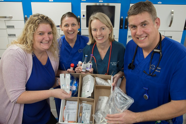 Ysbyty Gwynedd ....Betsi Cadwaladr University Health Board has launched a new 'Sepsis Box' which is available on all wards at the hospital and helps staff to deliver swift treatment for this life-threatening condition by providing all the medical equipment needed in one place.  Pictured with Tracy Savijn, RRAILS' (Rapid Response to Acute Illness) service improvement & development manager for BCUHB are Karen Roberts, Claire Bishop and Ben Goldsmith from the stroke team.