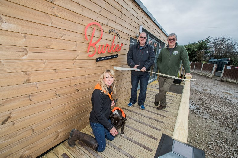 Official opening of North Clwyd Animal Rescue cafe , Doris's Bunker built by Rubicon. John Lyon from Rubicon with NCAR fund-raising manager Nicky Owens and David Davies.