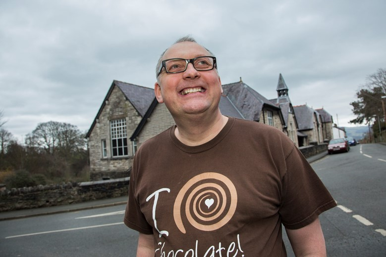 A new heritage walk around Denbigh  in aid of St Kentigen's Hospice, finishing off with a hot drink and some cake....Pictured is Mark Young from the chocolate shop at Denbigh Museum and Old court House one of the points of interest .