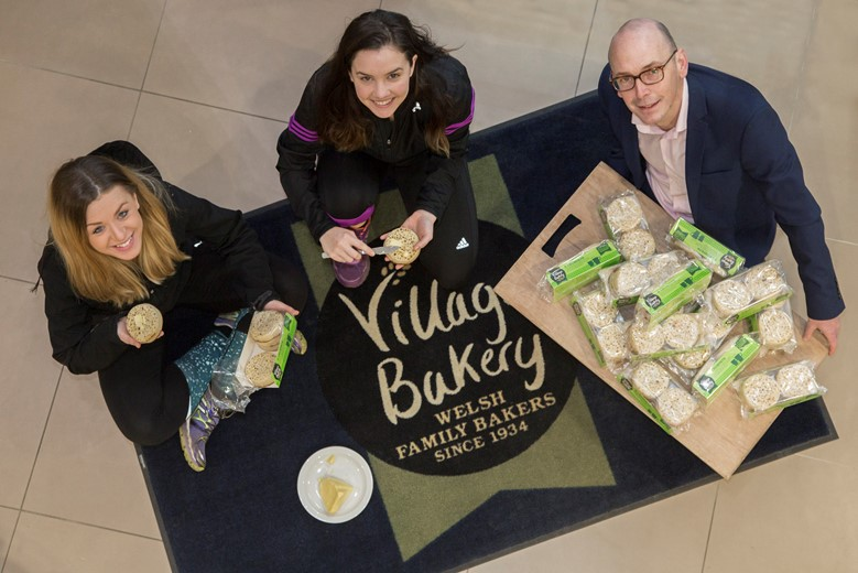 VILLAGE BAKERY, WREXHAM Half Marathon Pictured are Florence Roberts and Eileanøir Daly  from the Village Bakery who will be taking part with Mike Harrington  from Wrexham running club with the crumpets.