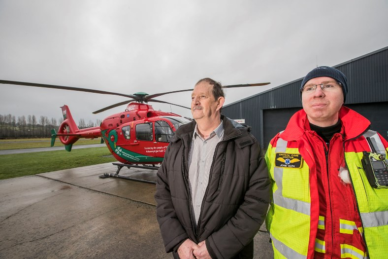Trevor Fletcher jas said thanks to BCUHB consultant anaesthetist  John Glen with the Wales Air Ambulance, who brought him back to life after  he collapsed at work, Toyota in Deeside, with a heart attack.