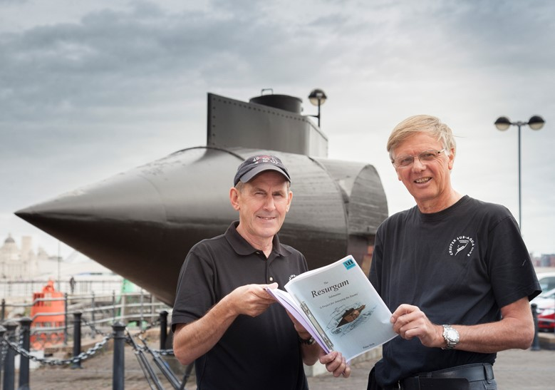 Chris Holden and fellow Chester scuba diver Dave Parry who are working to preserve the submarine wreck beneath the waves pictured close to the model at Woodside in Birkenhead